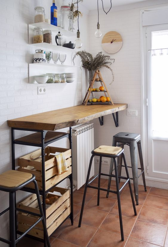 26 an industrial bar counter with crate storage, tall metal stools and floating shelves over the bar