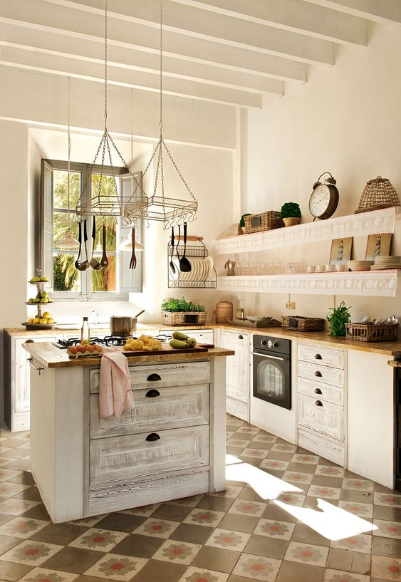 a neutral shabby chic kitchen with butcherblock countertops, a matching kitchen island with drawers for storage