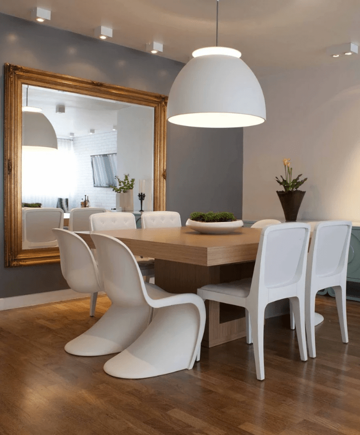27 a refined modern dining room with a square table and a mirror that echoes with it and cool modern sculptural chairs