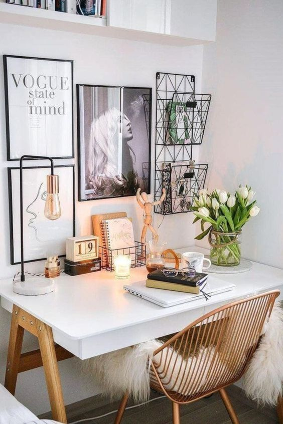 27 a small Nordic working space with a white trestle desk, a rattan chair, a lovely gallery wall, wire storage units and bulbs and candles