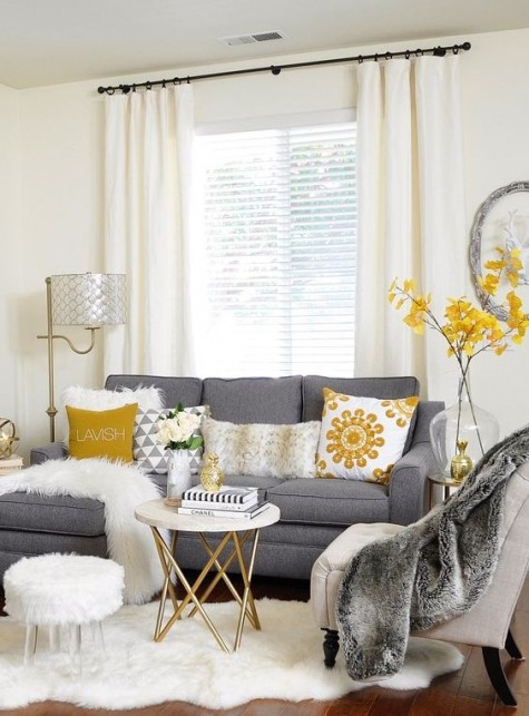 a neutral living room with trendy grey and yellow accents, a sectional grey Ektorp sofa with yellow printed pillows for a stylish look