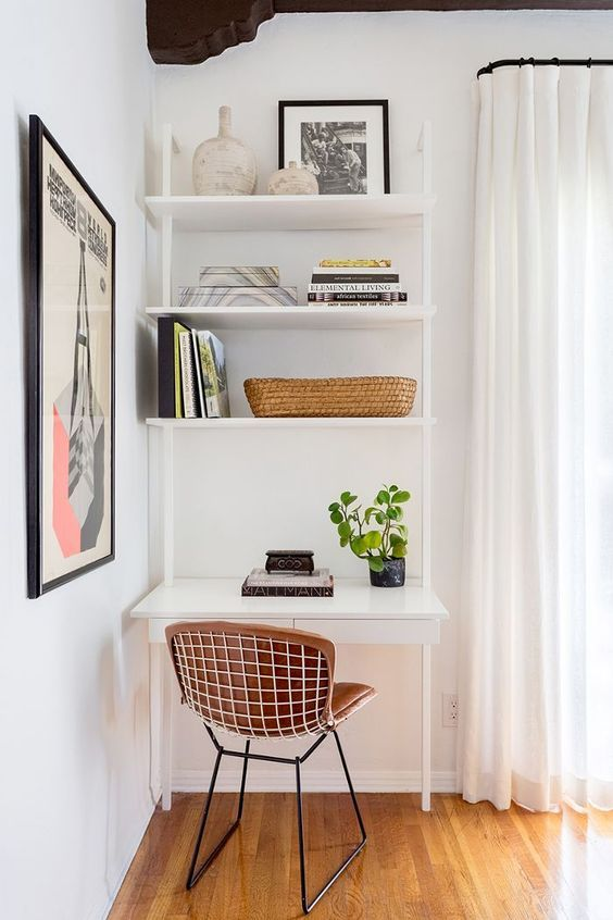 30 a modern workspace with a white storage, shelves, a sleek desk with drawers and a leather chair with metal legs