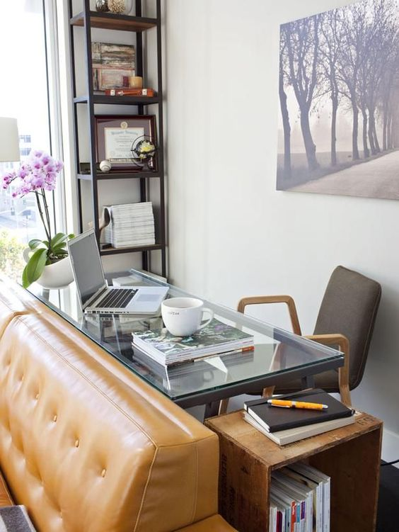 an elegant glass desk behind the sofa is a stylish idea to locate a small home office and make use of this awkward space