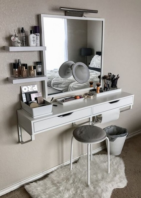 a Scandinavian makeup nook with IKEA furniture - a wall-mounted vanity, a matching mirror, a stool and some floating shelves