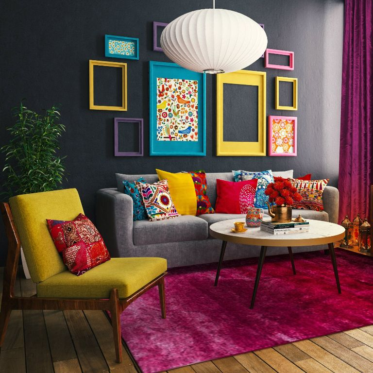 a bold mid-century modern living room with a black accent wall, a grey sofa, yellow chairs, a round table, a bright gallery wall with colorful frames