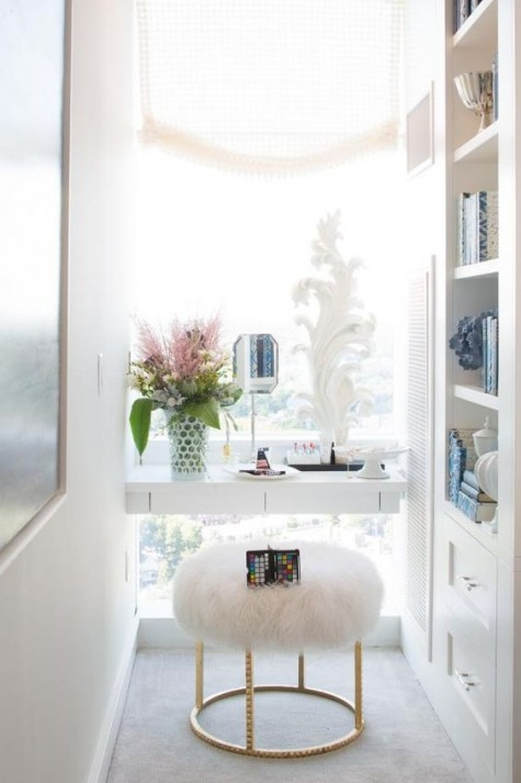 a built-in makeup nook with a vanity by the window, a faux fur stool doesn't take much space and features much natural light