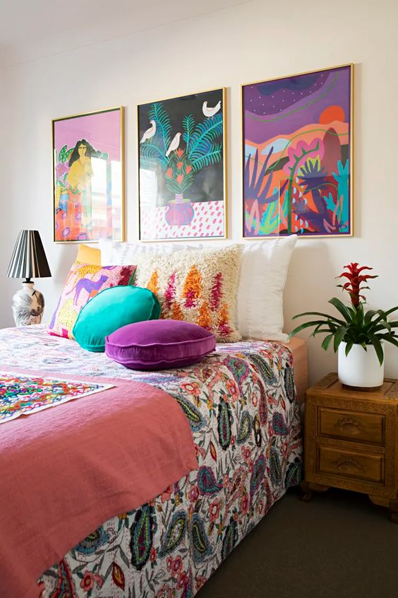 a cheerful bedroom made colorful with a bold gallery wall and bright bedding and pillows is a fun and cool idea to rock