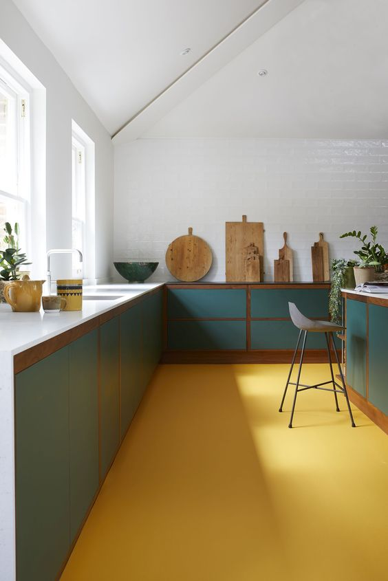 an edgy minimalist kitchen design with colorful touches