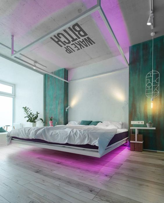 a gorgeous ultra-modern bedroom with a floating bed, pink neon lights and green touches is amazing