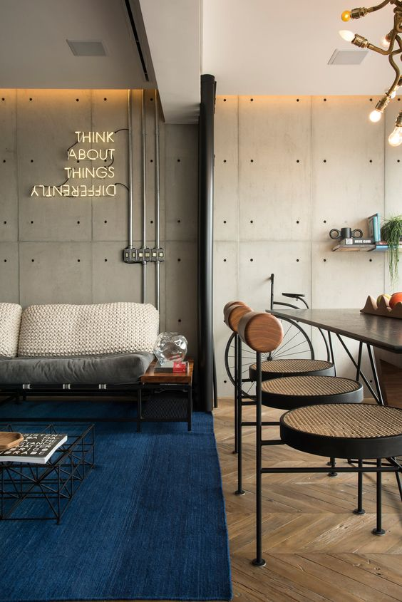 a stylish modern industiral space with a neon light that adds chic and interest to the space and makes it catchier