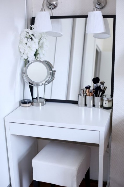 a tiny Scandinavian makeup space with an IKEA Micke desk, sconces, a couple of mirrors is comfy and welcoming