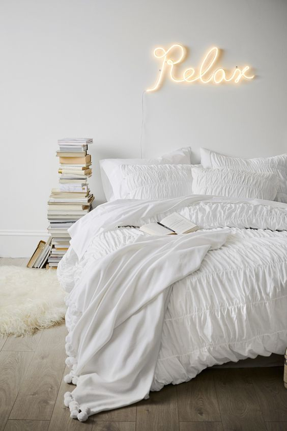a minimalist all-white bedroom design
