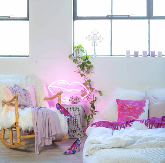 give a fun and girlish touch to your bedroom with such a cool lip neon light attached to the wall somewhere
