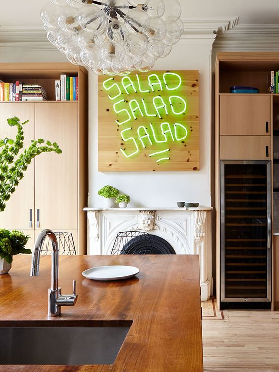 make your kitchen more quirky and fun with such an out of the box neon sign on a wooden plaque to give a fun touch