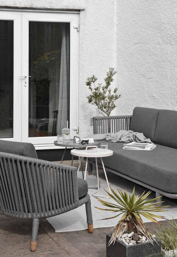 modern grey furniture with lovely matching upholstery and a duo of small coffee tables in the center for a modern space