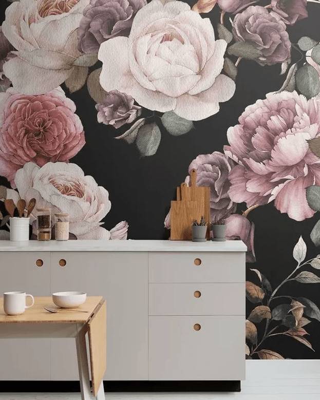 a lovely dove grey kitchen with realistic floral wallpaper on the wall and a cute stained folded table