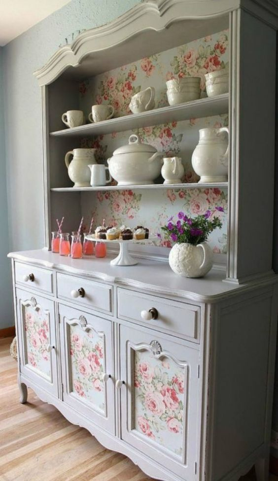 a vintage grey buffet renewed and renovated with vintage floral wallpaper inside is a very chic idea