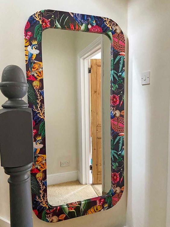 a cool IKEA mirror hack done with bright moody tropical wallpaper is an amazing idea to try