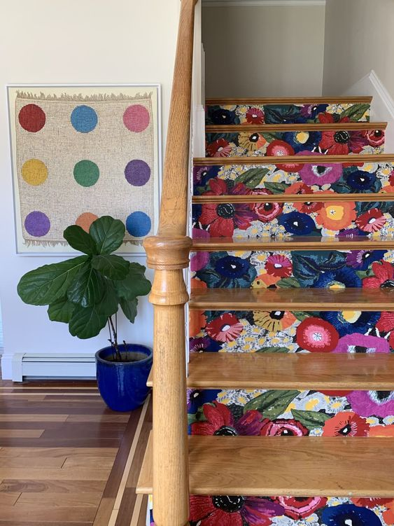 stair risers done with super bright floral wallpaper make the space more cheerful and cool