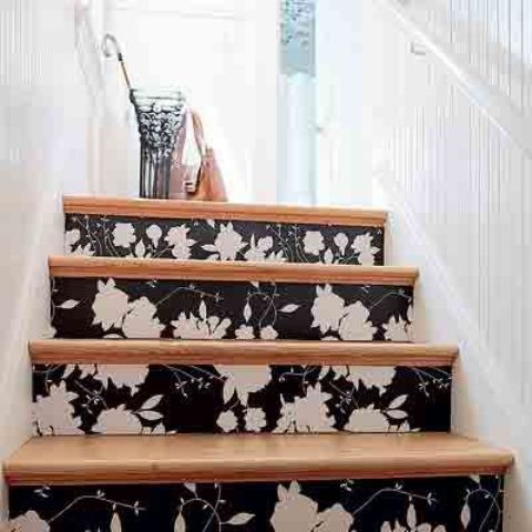 add an elegant touch to the staicase covering the risers with black and white floral wallpaper
