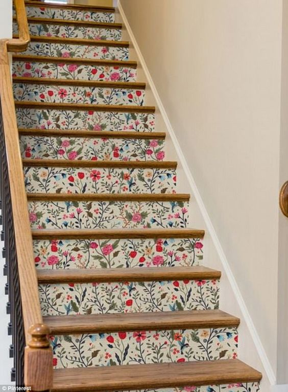 bright wildflower print wallpaper turns this staircase into a gorgeous and super colorful one