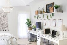 a cozy neutral bedroom with a home office