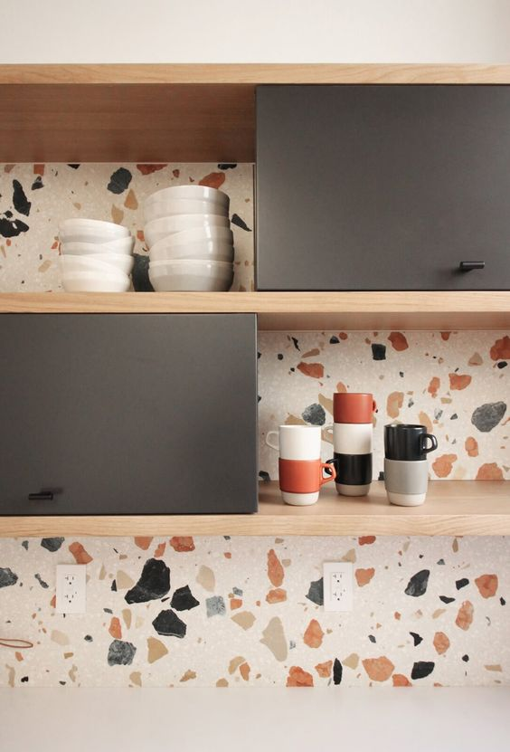 a catchy closed and opened kitchen cabinet with a bright terrazzo backsplash that adds catchiness and inteerst to the space