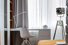 a chic bedroom with a large bed, a white laconic desk and a chair, neutral textiles is a very elegant space