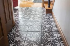 a chic entryway with a lovely black and white mosaic tile floor is a great idea to rock for a modern space