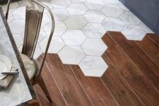 a chic transitional floor with rich stained laminate and white marble hexagon tiles is a very chic and bold idea