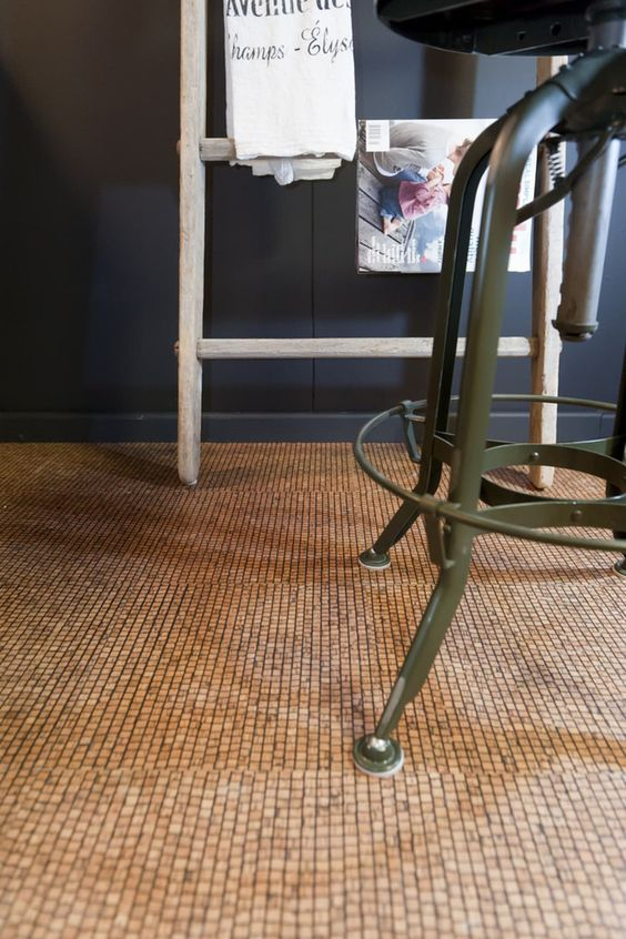 a lovely textural cork floor like this one will feel natural, warm and will make the room very welcoming and cool