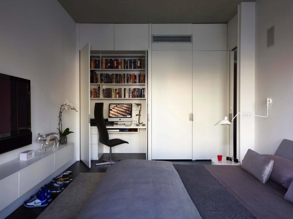 a practical home office in a bedroom's closet