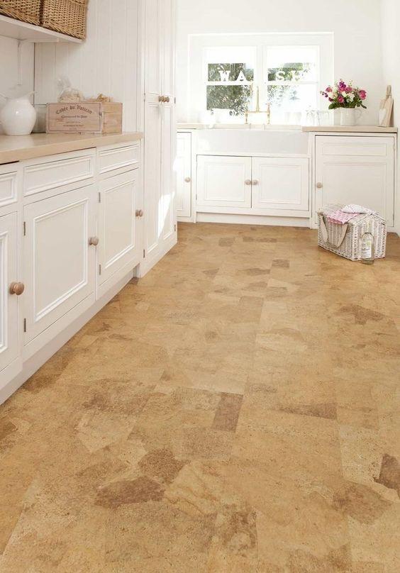 a farmhouse kitchen with cork flooring