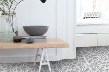 a pretty Scandinavian space with white walls and a printed vinyl floor, a bench and a windowsill seat with drawers is wow