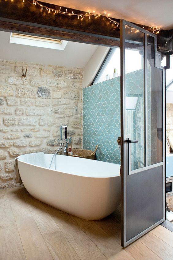 a cozy attic bathroom design with bamboo flooring