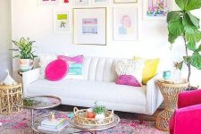 a super colorful smmer living room with a bold gallery wall, a white sofa, a colorful rug and a pillow, a hot pink chair is fun