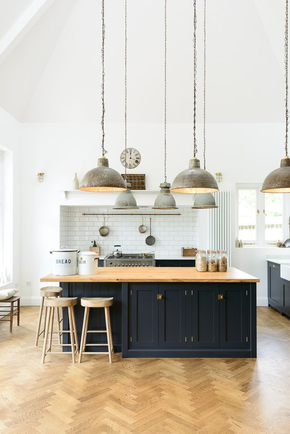 a stylish light-filled industrial kitchen design