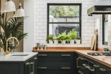 a cute black kitchen design with white walls