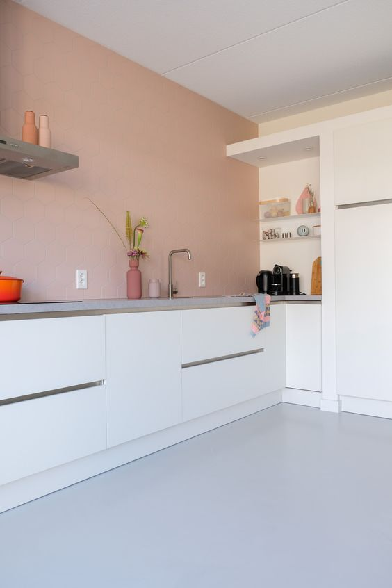 a minimalist kitchen could feature a pink wall