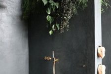 10 a minimalist bathroom done with concrete and with climbing plants on the wall to feel like having a shower outside