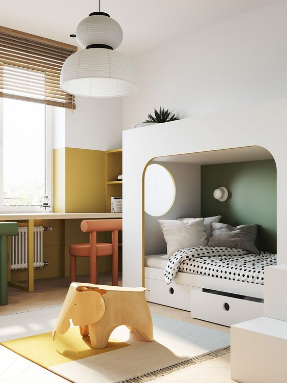 a minimalist kid's room with color block mustard and white walls, a color block rug and a green accent wall