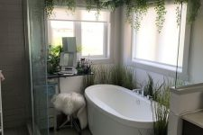 11 a cozy little bathroom with lots of plants, faux and real ones and with windows for natural light
