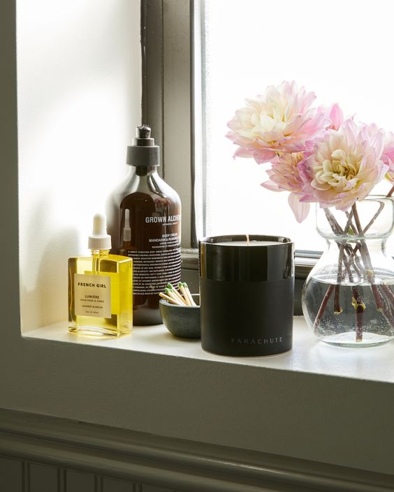 various home scens and a scented candle will help you create a mood and a summer feel in your bathroom