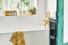 18 a lovely bathroom with pretty bright textiles – towels and a rug with a sunny yellow touch is welcoming