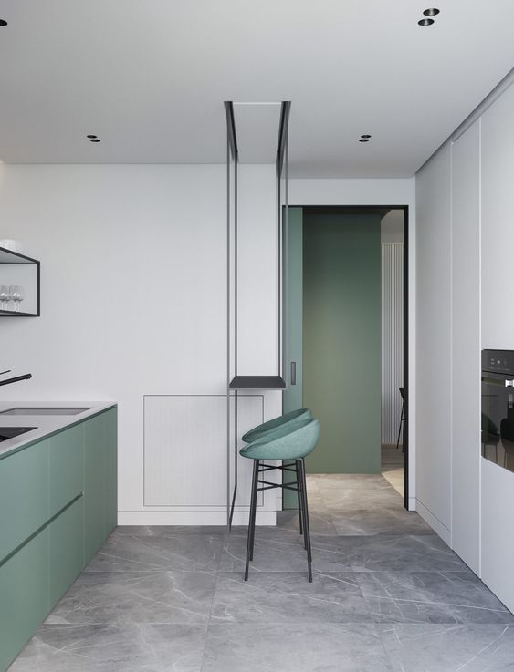 a minimalist kitchen with sleek green cabinets, white cabinets and a built-in oven, green stools and black fixtures
