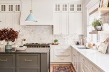 22 a chic farmhouse kitchen with elegant white cabinetry, a grey kitchen island, a hidden hood on the wall and a white tile backsplash