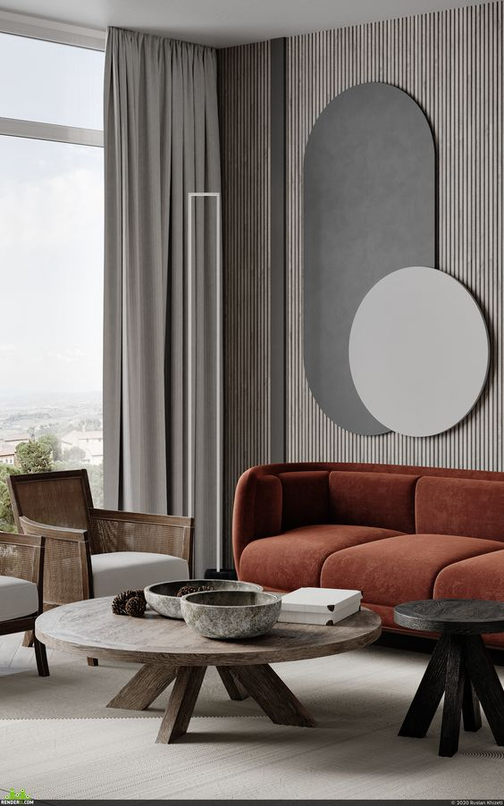 a refined minimalist living room with a wood slba wall, a rust-colored sofa, a round wooden table and cane and rattan chairs