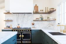 27 a lovely modern farmhouse kitchen with navy cabinets and a white hood that matches the wall, open shelves and marble countertops