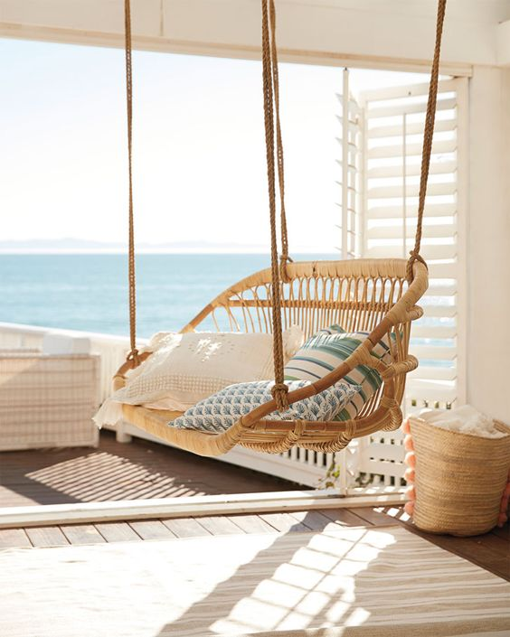 a suspended rattan chair with lots of pillows is always a good idea and it will easily match almost any outdoor space