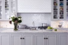 a grey kitchen with a kitchen island that makes a statement